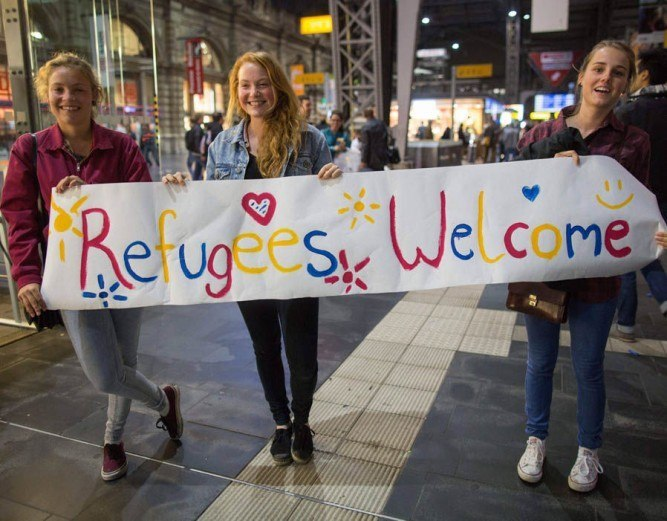 The Manosphere Is Enemy Propaganda girls welcome refugees 1 667x521 White Nationalism nationalism  us canada politics government other europe