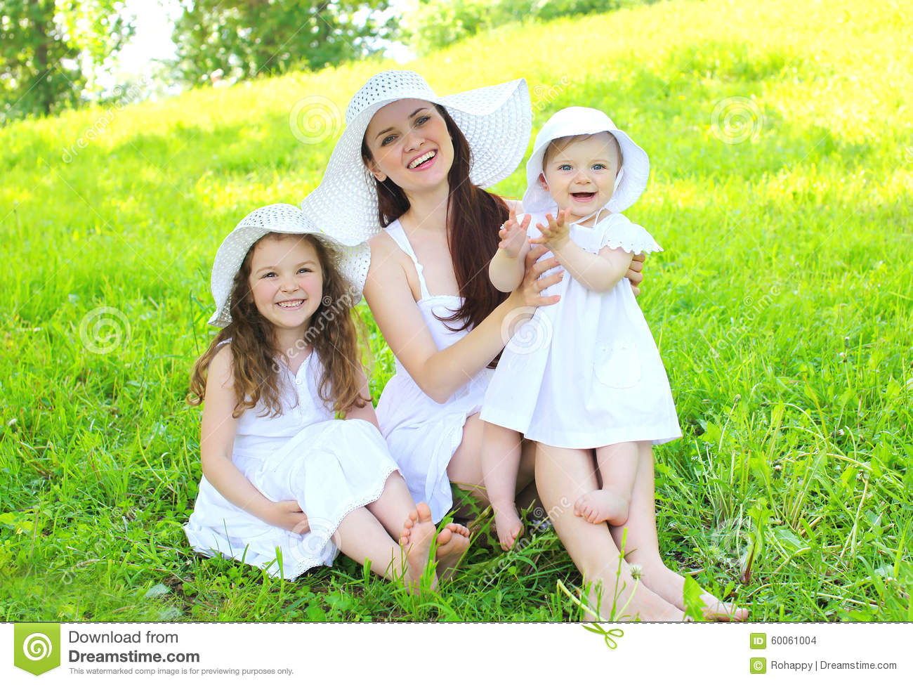What the English speaking world has done for us. happy smiling mother two children wearing white dress straw hats grass summer 60061004  us canada society culture politics government politics news history europe